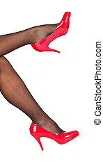 Red shoes with black stockings