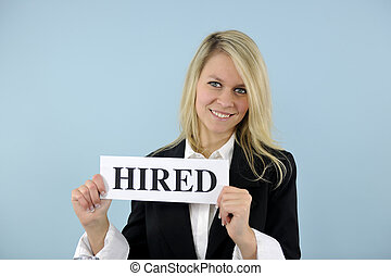 young busineswoman holding hired sign - happy young...