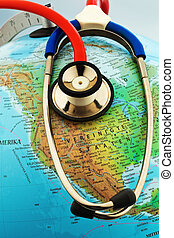 globe and stethoscope - a stethoscope on a globe showing the...