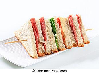 Multi-layered salami sandwich - Multi-layered sandwich with...