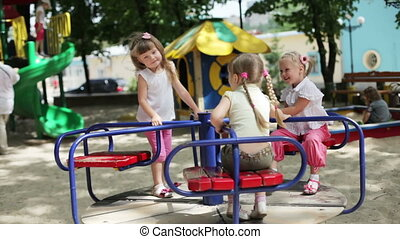 Three happy girls on the playground