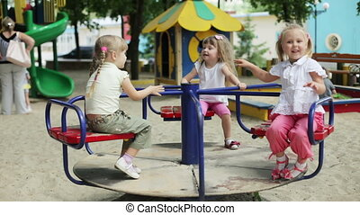 Children wave their hands on the ca - Kids on the playground