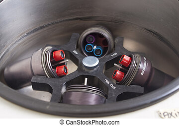 Centrifuge with blood samples - Rotating centrifuge loaded...