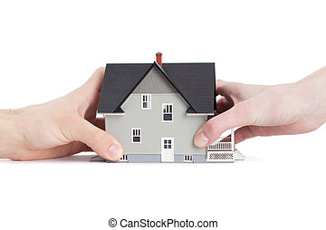 Two hands trying to divide house, isolated - Real estate...