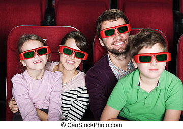 Happy family in 3D movie theater