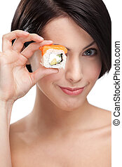 Young girl holding sushi in her hand, isolated on white