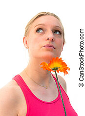 woman with a flower and thinking about love - charming young...