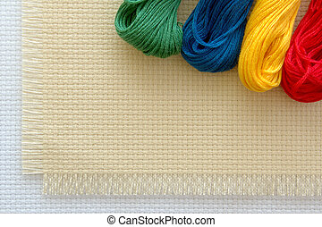 cross-stitch - Coloured threads floss and the canvas for the...