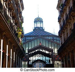Barcelona Borne market facade in arcade street