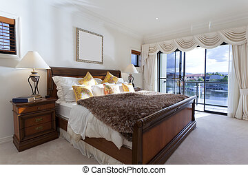 Spacious master bedroom in luxury house overlooking the...