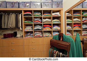 Male walk in wardrobe with shirts, pants, belts and drawers