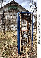 Old Vintage Gas Pump and Abandoned house