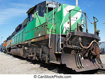Freight Train - Green and weight freight train with blue sky...