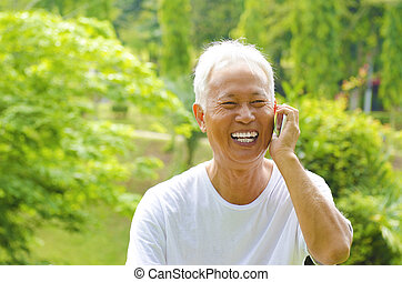 Senior on the phone - Healthy senior Asian man on the phone...