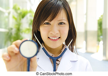 Medical student - Asian medical student with stethoscope in...