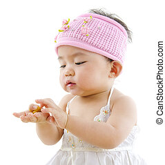 I can eat by myself - Cute pan Asian baby girl eating on...
