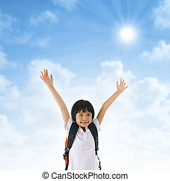 Asian school girl arms up in the air - 7 years old pan Asian...