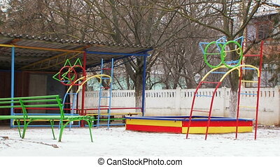Snow covered playground - Childrens playground with colorful...