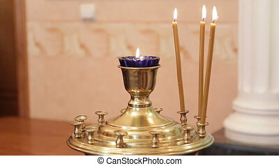 Christian rite - Burning candles in golden candlestick. Part...