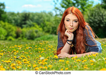 redhaired - Romantic young woman  outdoors at a summer day.