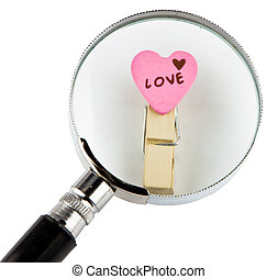Love word and magnifying glass Image