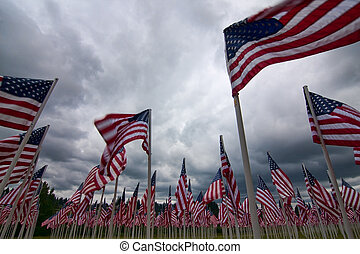 A patriotic arrangement of american flags representing...