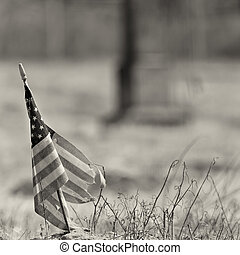 Black and white photo of a worn out american flag