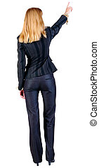Back view of young blonde business woman pointing