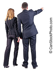 Back view of  pointing business team