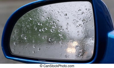 Rain on car front window.