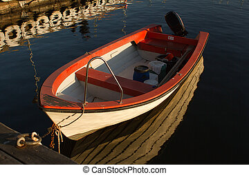 Red fishing boat - single red fishing boat moored in lysekil