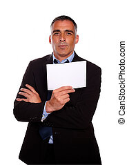 Mature business man holding a white card - Portrait of a...