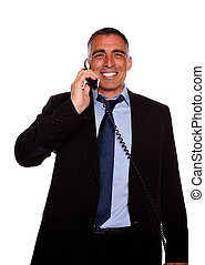 Charismatic businessman laughing on phone