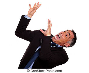 Excited hispanic businessman screaming