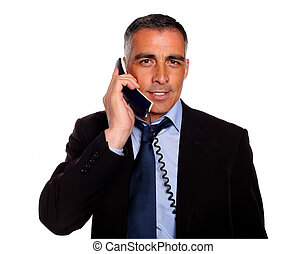 Attractive and gorgeous businessman with a phone