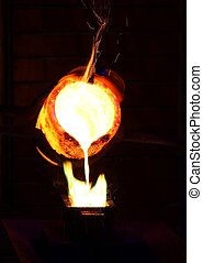 Gold Pouring - Molten gold being poured to form an ingot bar