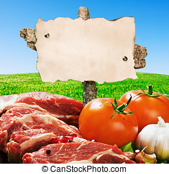 recipe for cooking vegetables and meat - hand holding an...