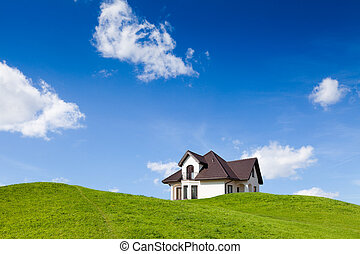 Small family house on green field with blue sky