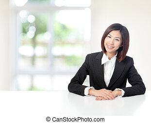 Business woman smile and sit at office - Young Business...