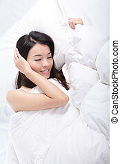 young woman sleep on bed
