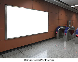 Blank billboard in subway station entrance path in the image...