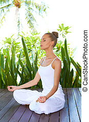 Woman in lotus position meditating - Stylish beautiful woman...