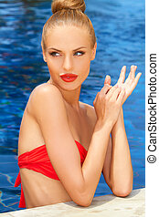 Gorgeous blonde lady in the pool - Gorgeous blonde lady in a...