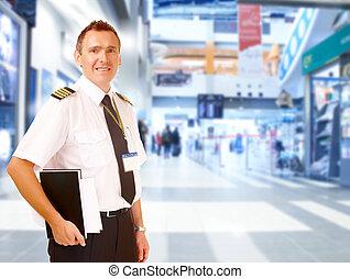 Airline pilot at airport - Airline captain pilot wearing...