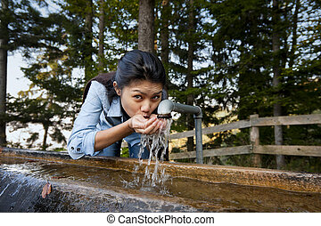pretty woman drinking water - beautiful young woman drinking...