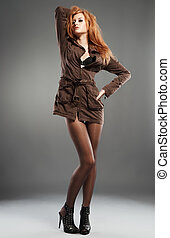 Sexy red haired fashion model