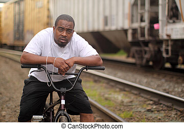 Man on BMX bike - Young black man on a BMX bicycle