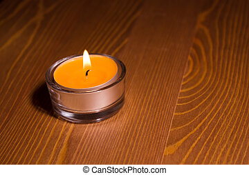 Candle on wooden table