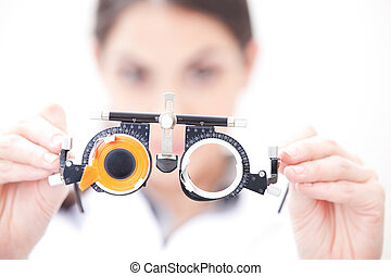 Doctor In Ophthalmology Clinic - Optometrist holding a eye...