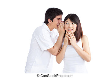 Man Whispering Woman's Ear - Portrait of young man...
